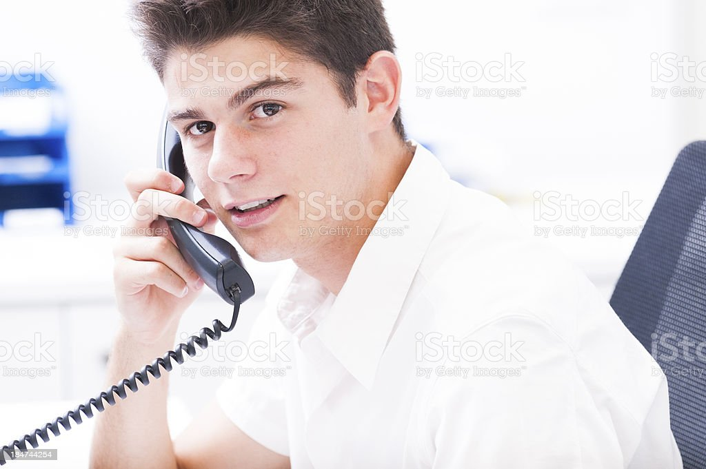 young man is calling royalty-free stock photo