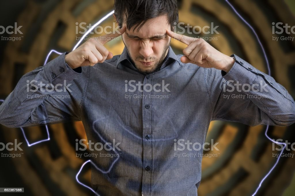Young man is concentrated and looking for solution for difficult task. stock photo