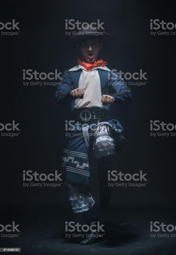 Young Man Is Dancing Folk Gaucho Dance stock photo