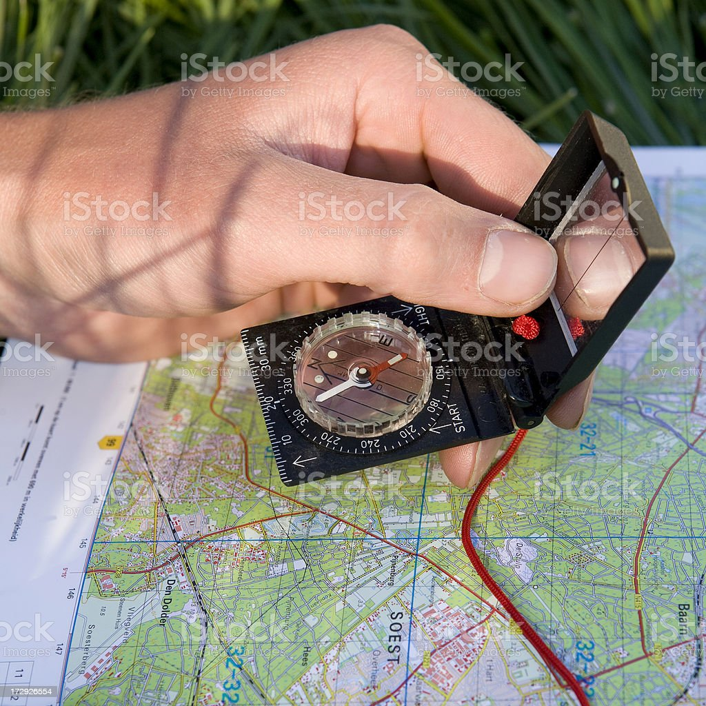 Young man is discovering the map compass royalty-free stock photo
