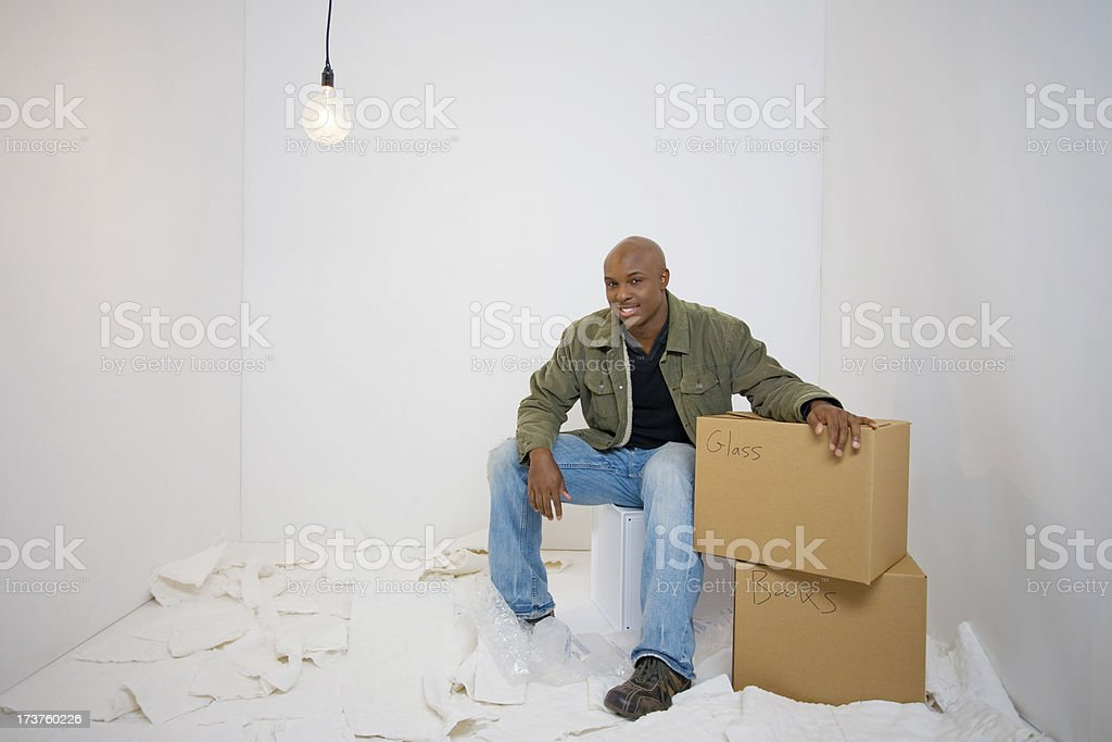 Young man is happy to be packing for a move royalty-free stock photo