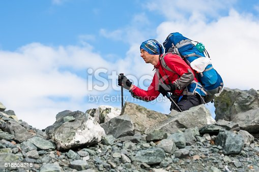 istock Young man is hiking in highlands of Altai mountains, Russia 618858218