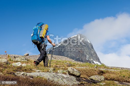 istock Young man is hiking in highlands of Altai mountains, Russia 618858424