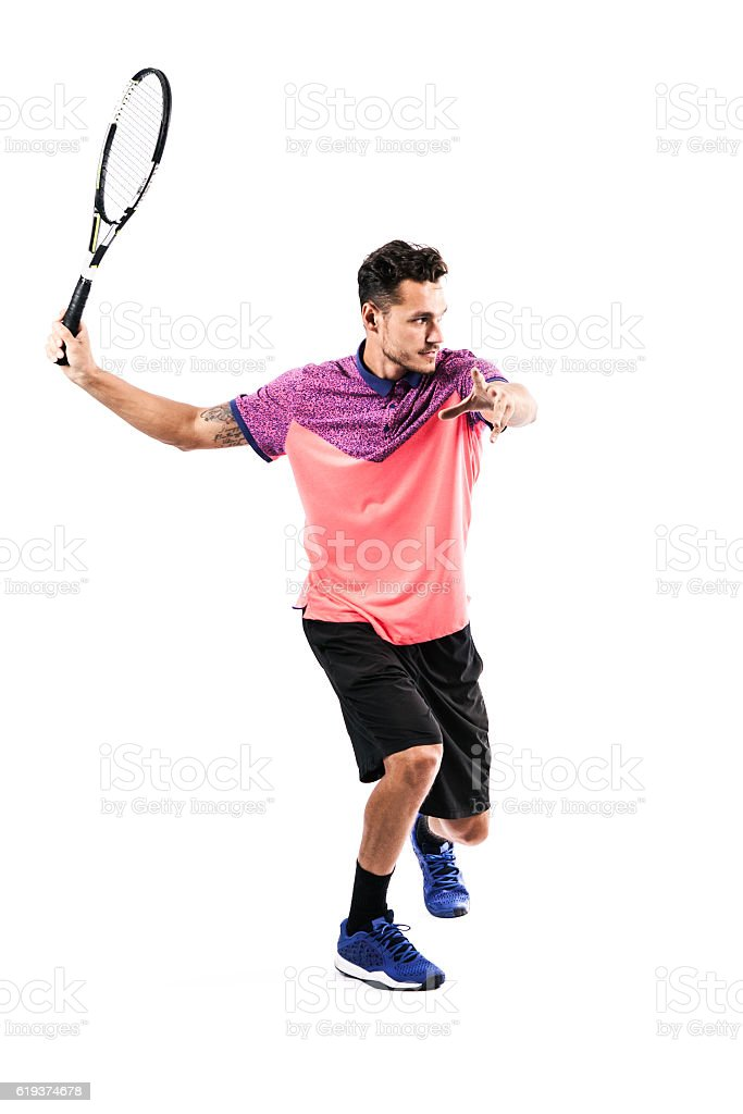 Young man is playing tennis stock photo