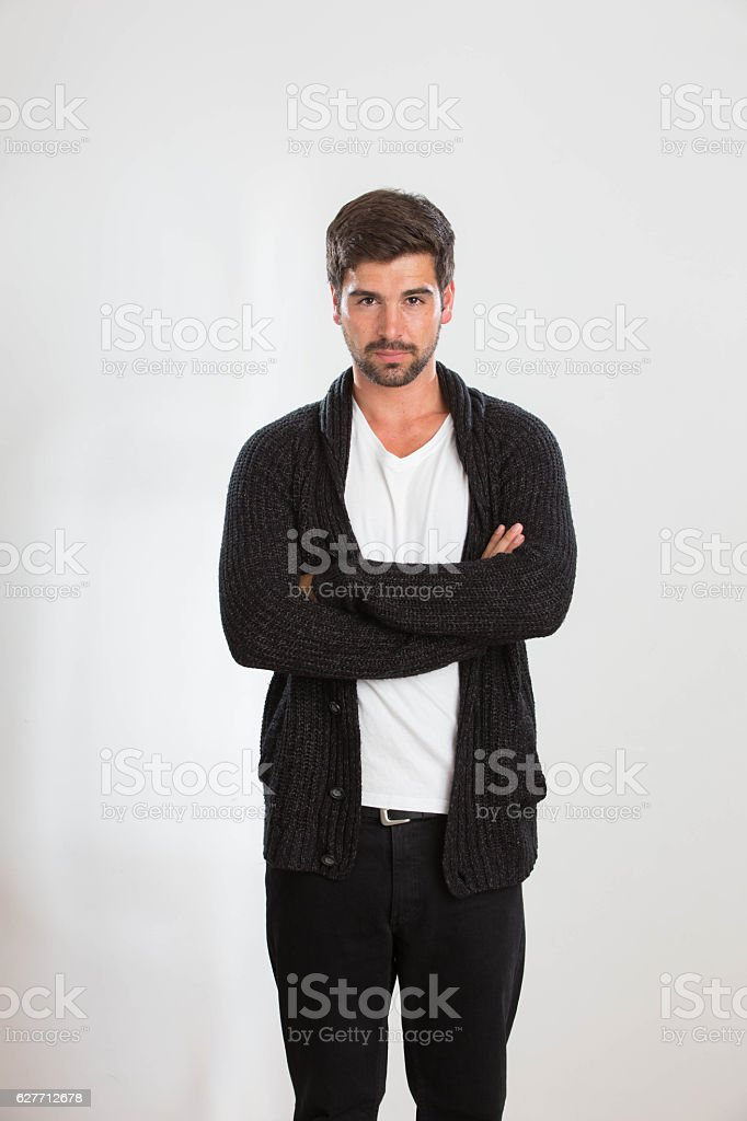 Young man is posing in a studio stock photo