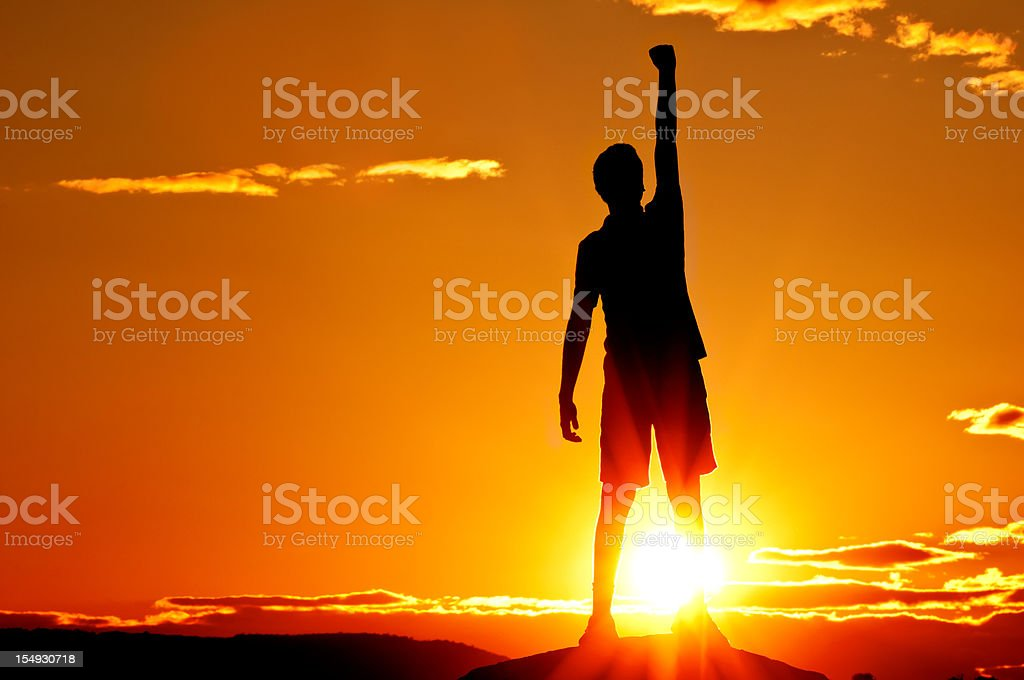 Young man is punching air in celebration, sunset scenery (II) stock photo