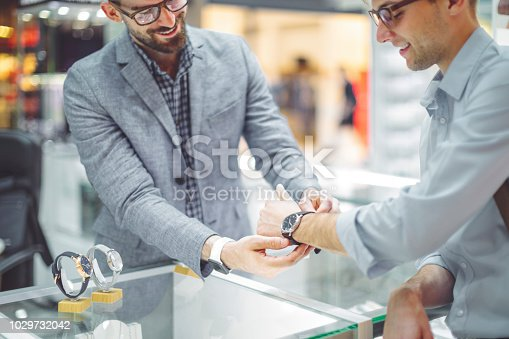 istock Young man is shopping for a watch 1029732042