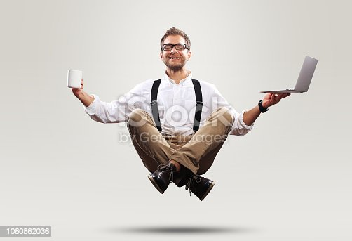 istock Young man is soaring in the air 1060862036
