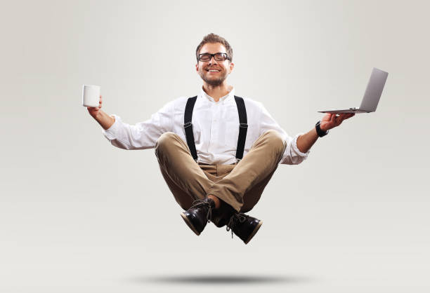Young man is soaring in the air stock photo