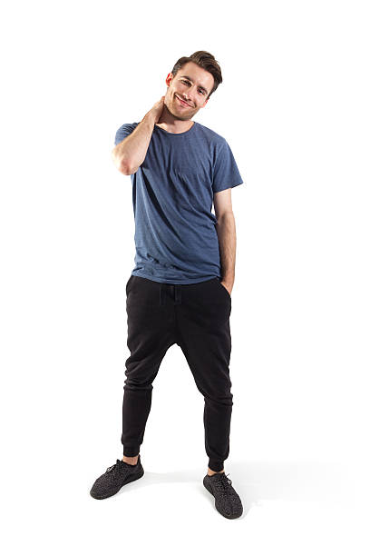young man, isolated with clipping path - sweatpants stock-fotos und bilder