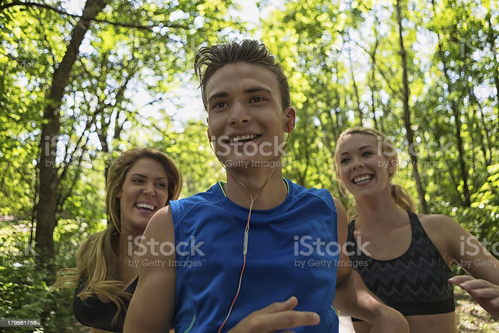 Young Man Jogging In Front Of Woman royalty-free stock photo