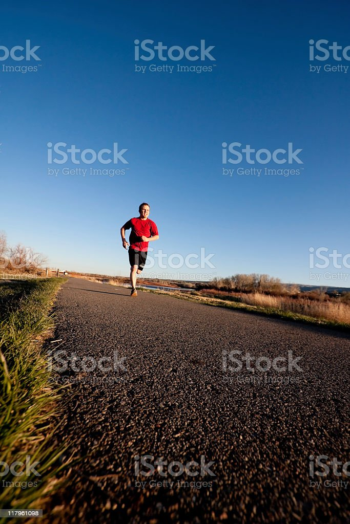 Young Man Jogging royalty-free stock photo