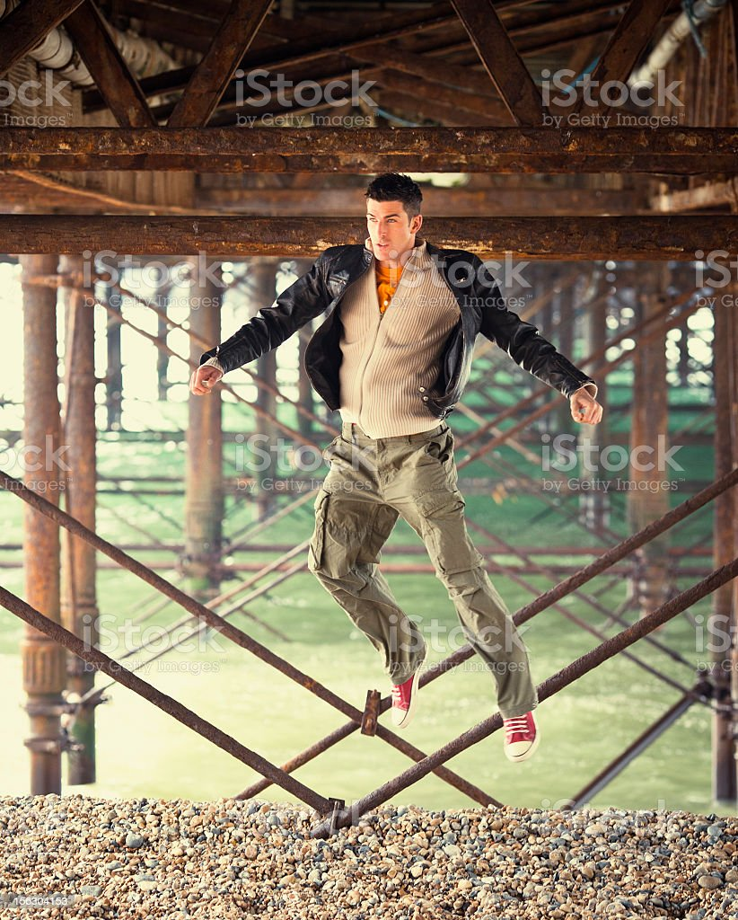 young man jumping and goofing around stock photo