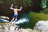 Young man jumping from a waterfall at Lumiar/RJ