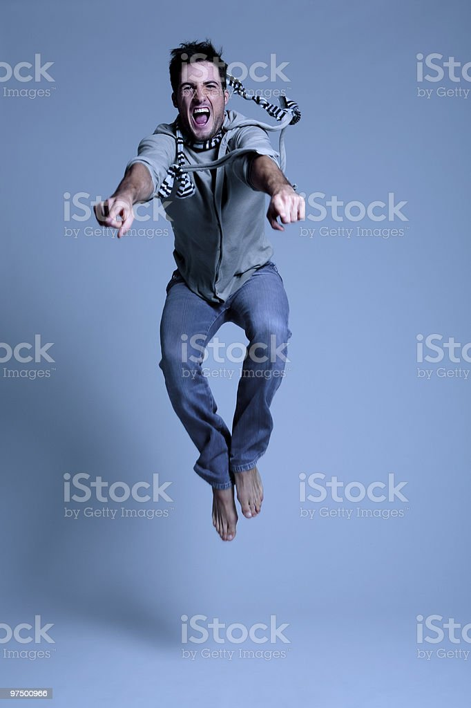 Young man jumping in excitement royalty-free stock photo