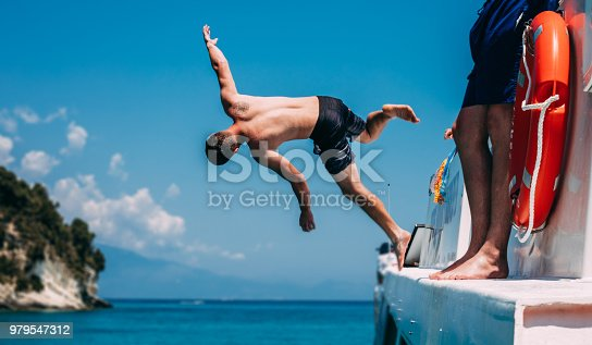 Young Man Jumping in the Sea from a Boat.