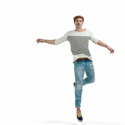 Young man jumping over isolated white background. Image taken with Hasselblad H5D 50C camera system and developed from camera RAW.