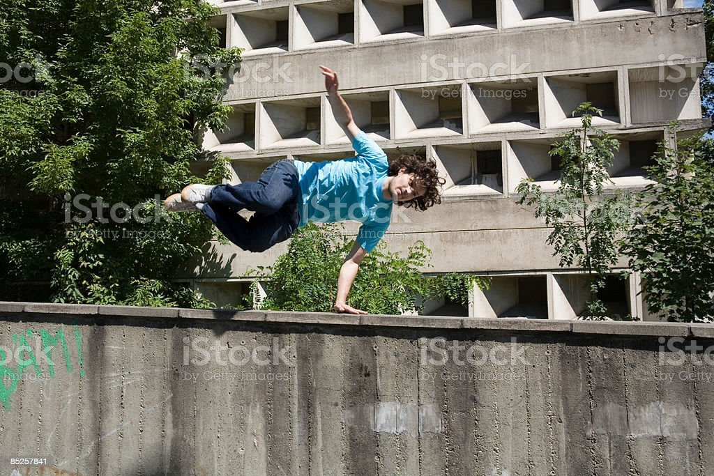 Young man jumping wall royalty-free stock photo