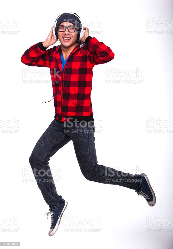 Young man jumping with music headphones stock photo