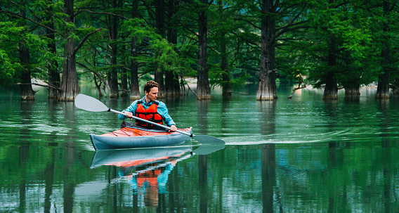 istock Young man kayaking outdoor. 824974334