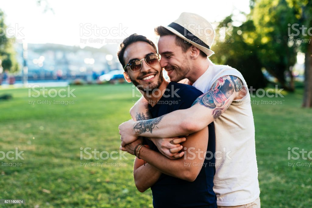 Young man kissing his boyfriend for farewell stock photo
