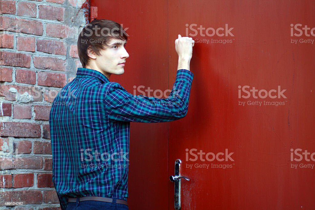 young man knocking stock photo