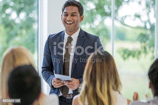 862718922 istock photo Young Man Leading the Discussion 693469168