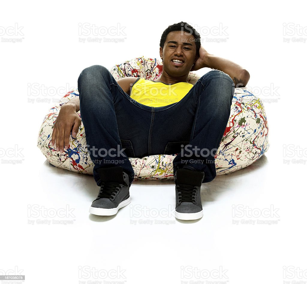 Young man leaning on a bean bag royalty-free stock photo