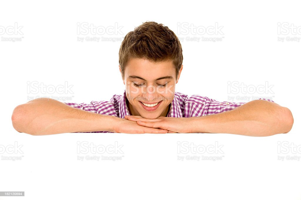 Young man leaning on a billboard royalty-free stock photo