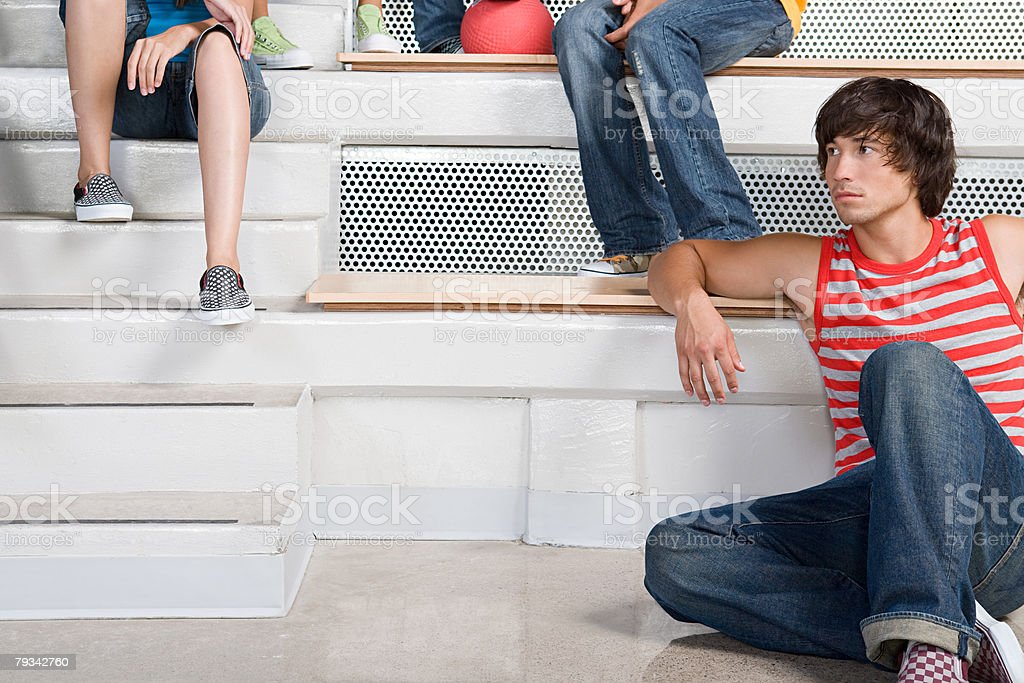 Young man leaning on a seat 免版稅 stock photo