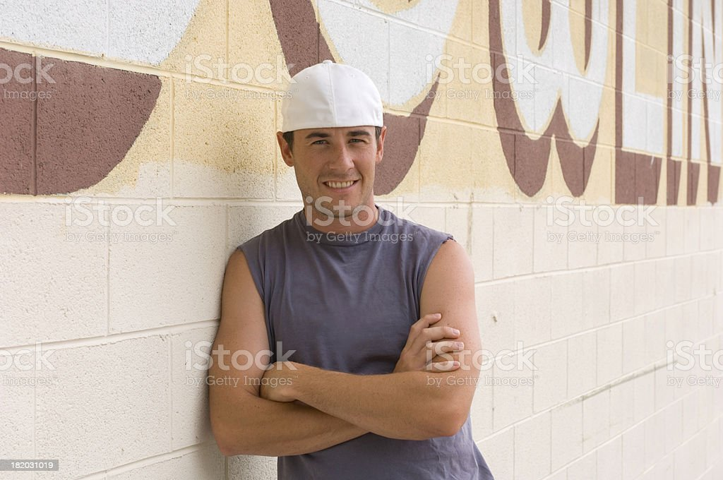 Young Man Leaning on Wall royalty-free stock photo