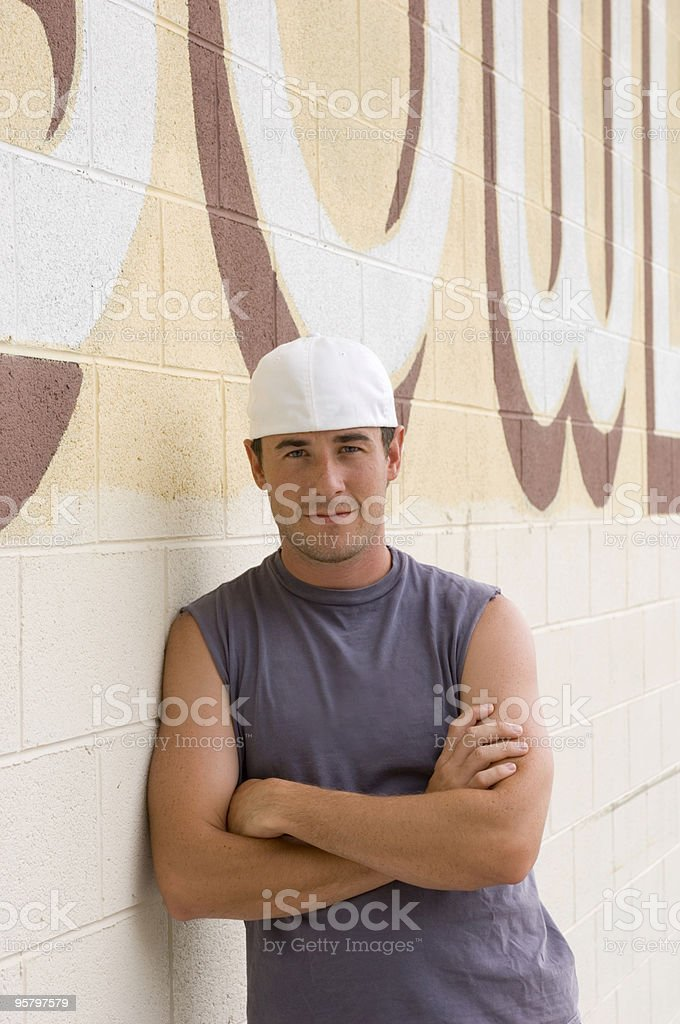 Young Man Leaning on Wall stock photo
