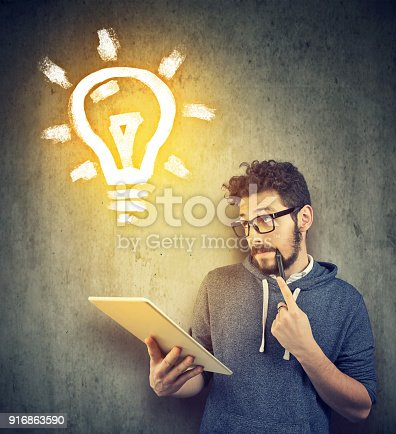 istock Young man learning with tablet 916863590