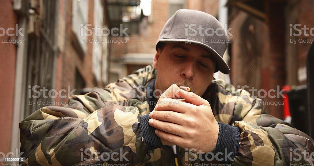Young Man Lighting a Smoke royalty-free stock photo