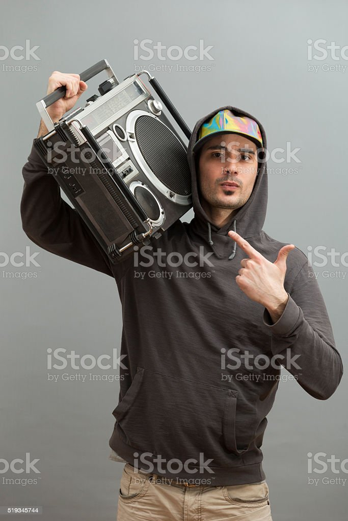 Young Man Listening Boombox stock photo