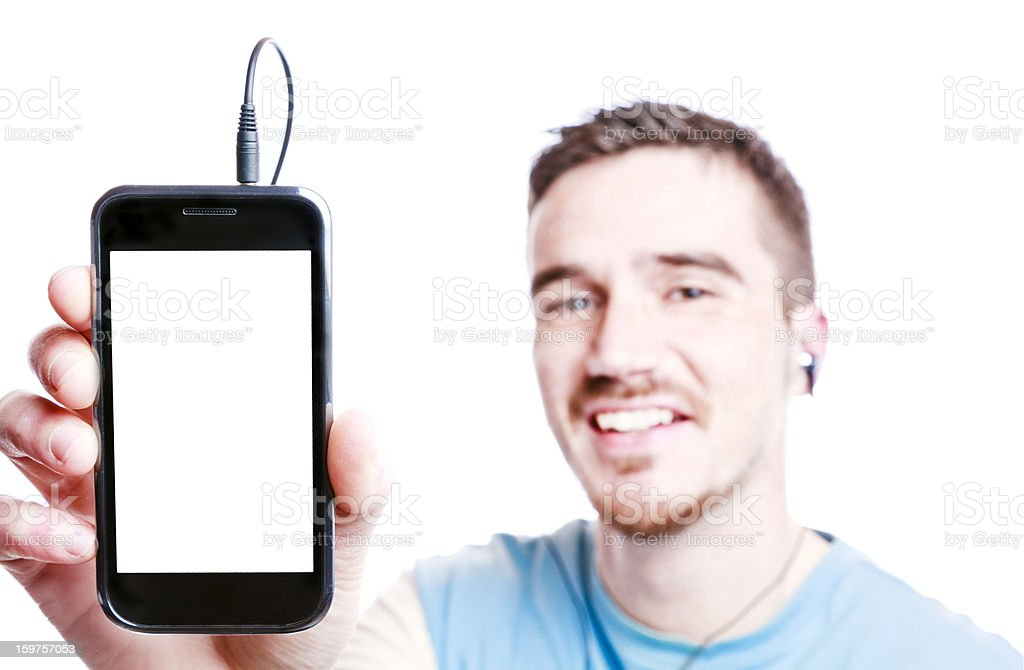 Young Man listening Music on Smartphone stock photo