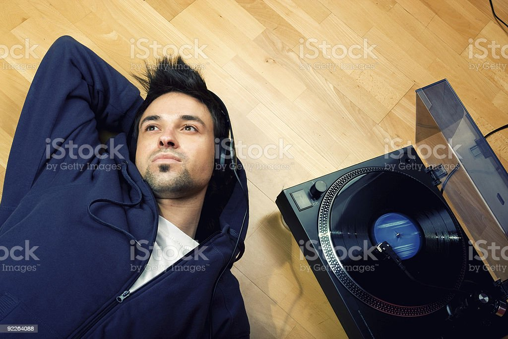 Young man listening music stock photo
