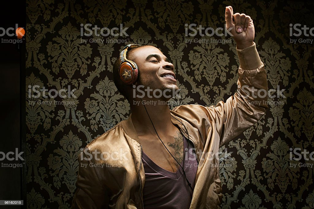 Young man listening to music and dancing stock photo
