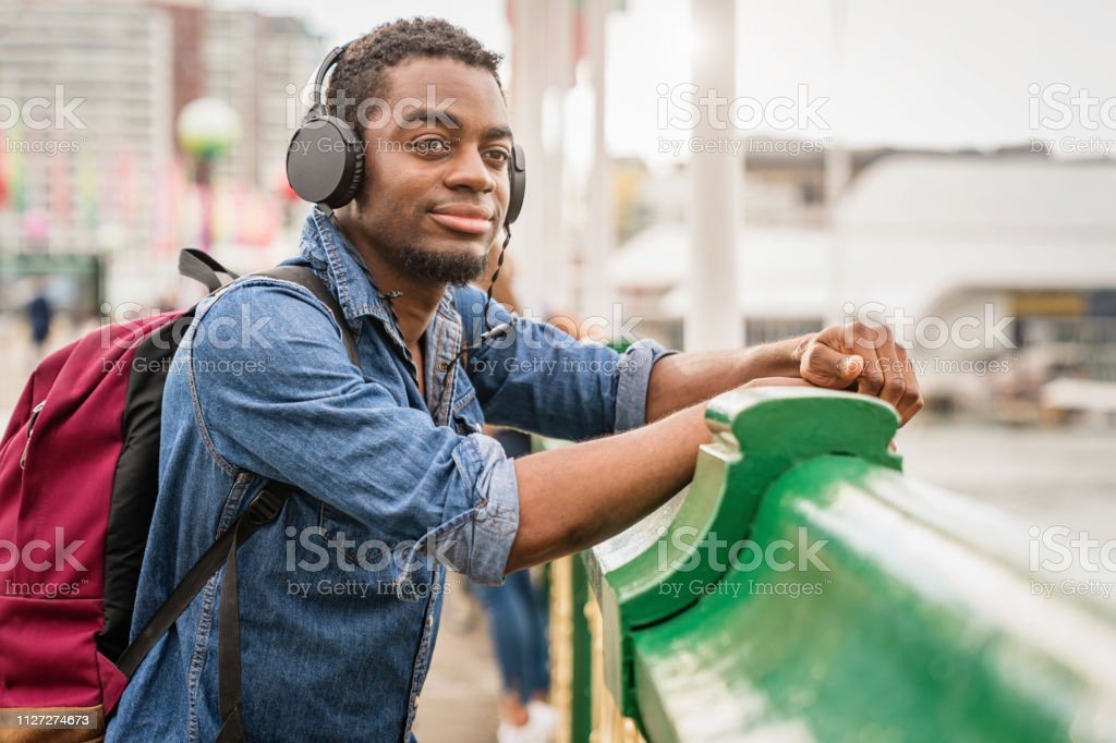 Young Man Listening To Music Darling Harbour Sydney stock photo