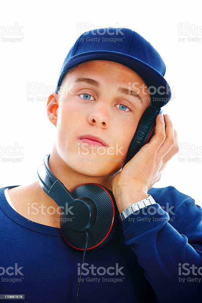 Young man listening to music with headphones royalty-free stock photo