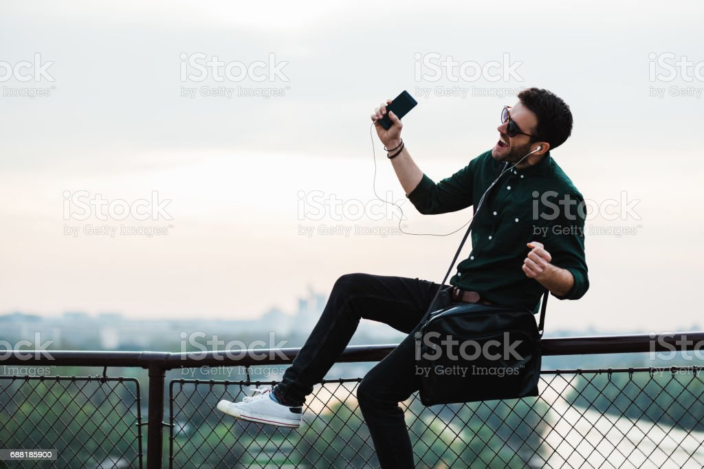 Young man listening to the music stock photo