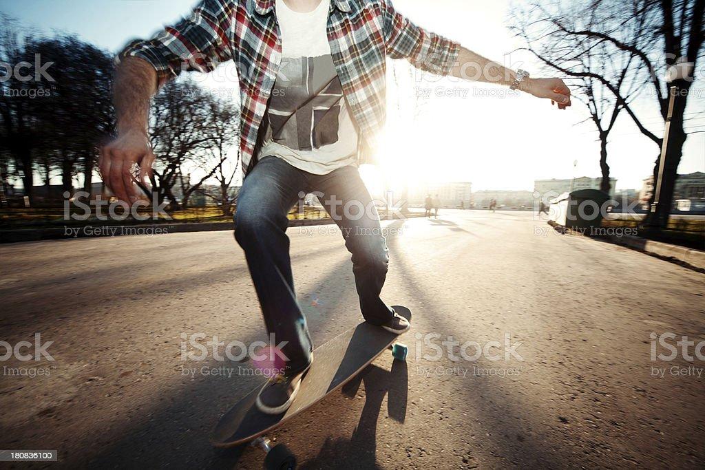 Young man longboarding in an urban environment stock photo