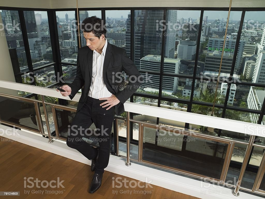 Young man looking at cellphone royalty-free stock photo