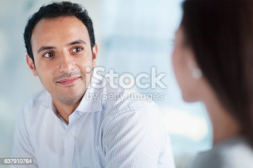 istock Young man looking at colleague in office 637910764