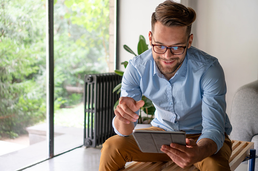 Young Man Looking At Digital Tablet Stock Photo - Download Image Now