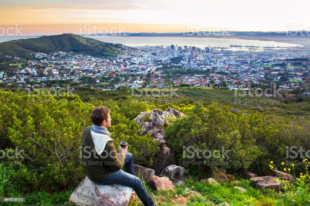 Young man looking at view of the city of Cape Town stock photo