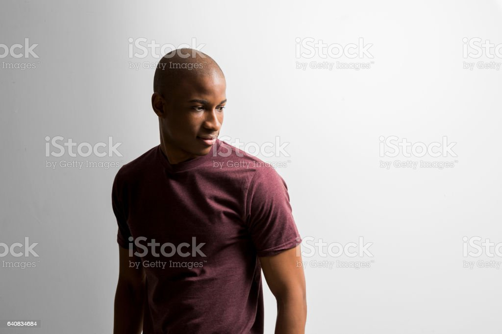 Young man looking away against white background stock photo