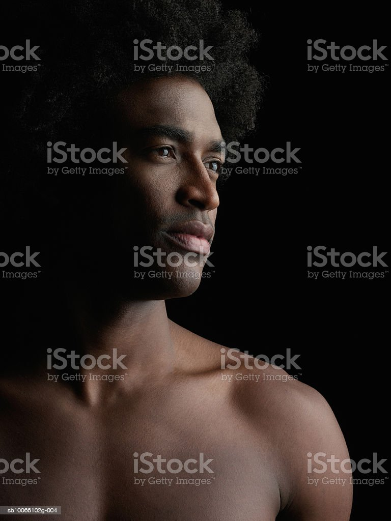 Young man looking away, close-up royalty-free stock photo