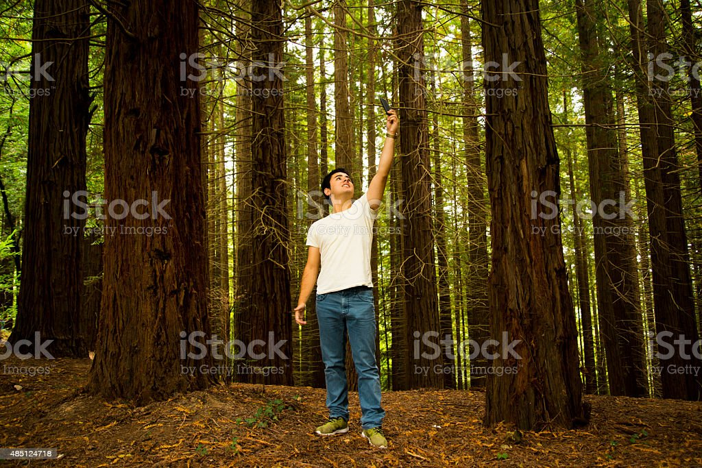 Young man looking for signal stock photo
