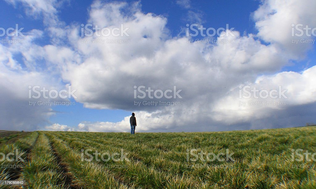 Young Man Looking into Blue Cloudy Sky royalty-free stock photo